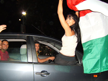Diletta with Italian flag (450Wx338H) - Party on the road!...  (Photo by Danette St.Onge)